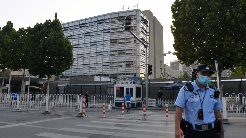 A policeman patrols outside the US embassy in Beijing