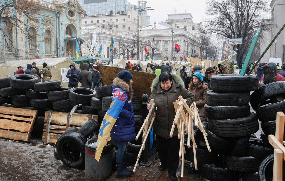 Supporters of the former Georgian president and ex-Odessa Governor Mikheil Saakashvili setup a barricade in their tent camp near of Parliament building in Kiev