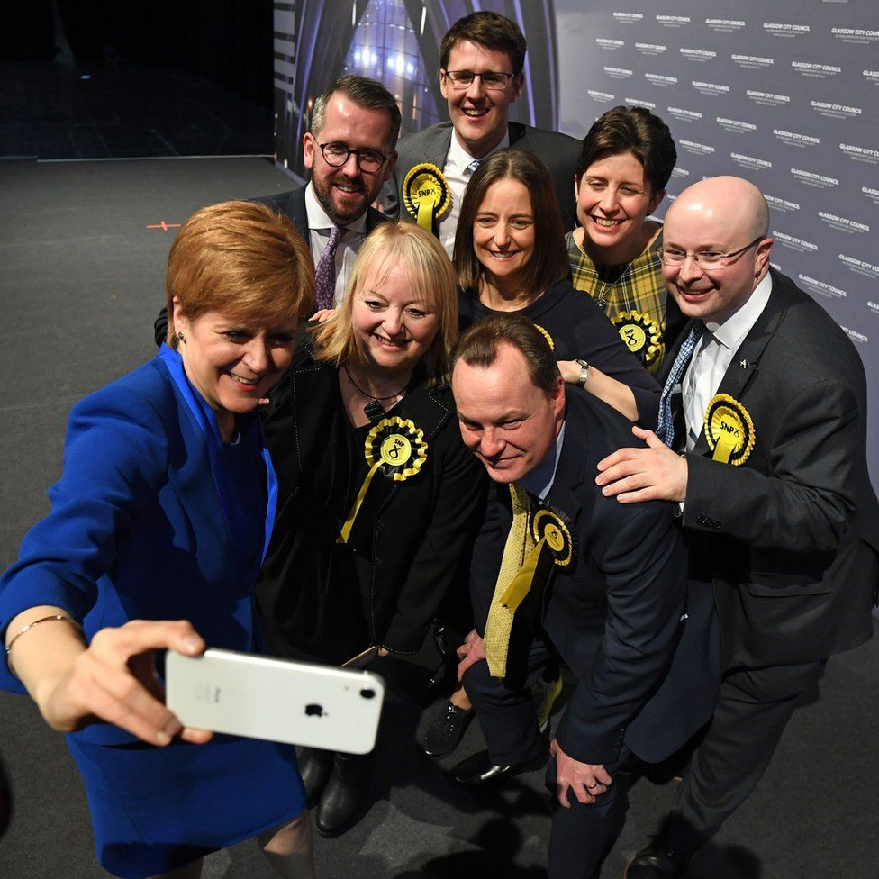 Scottish National Party (SNP) leader and Scotland's First Minister Nicola Sturgeon (L) takes a selfie photograph with her Glasgow MPs
