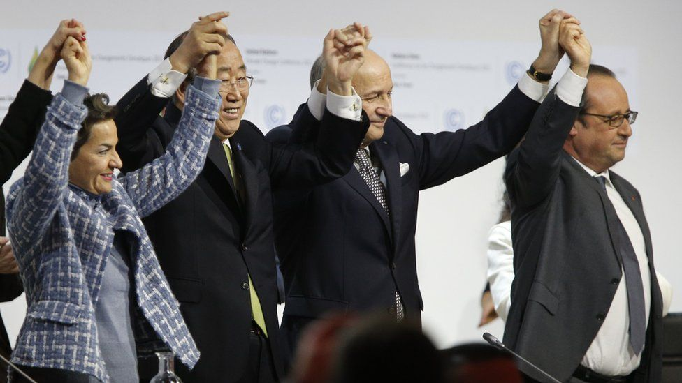 UN Secretary General Ban Ki-moon, French Foreign Minister Laurent Fabius and French President Francois Hollande celebration the adoption of the Paris agreement