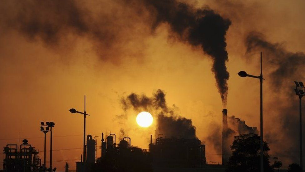 Smoke billows from chimneys at a chemical factory in Hefei, China. Archive photo