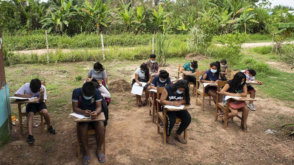 Indigenous students learning outside in Peru