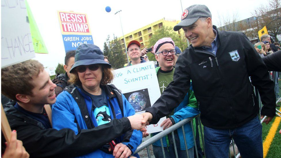 Washington state Governor Jay Inslee shakes hands with people in the crowd after speaking at a rally during the March for Science at Cal Anderson Park on April 22, 2017 in Seattle, Washington.