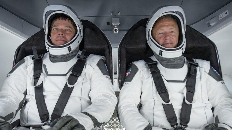 Astronauts Bob Behnken (L) and Doug Hurley (R)