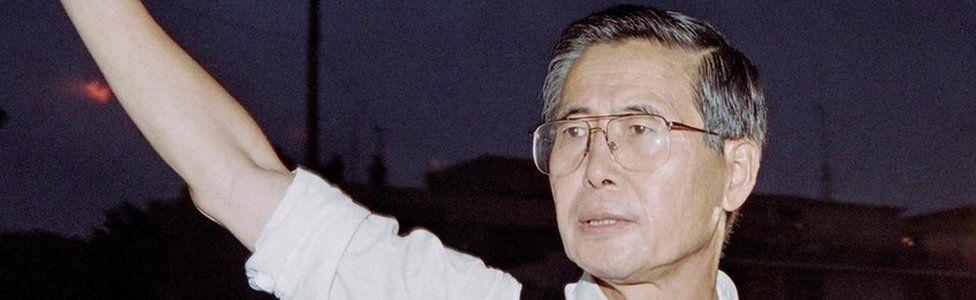 Alberto Fujimori waving as he leaves the residence of the Japanese ambassador in Lima, 22 April 1997