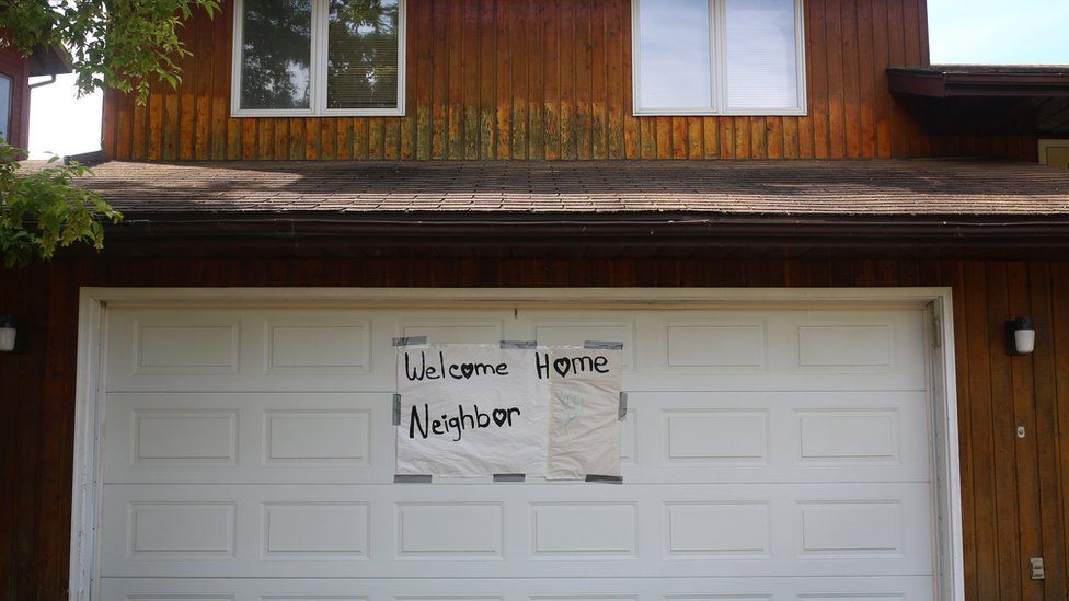 A welcome home sign left on a garage door in the Thickwood neighbourhood of Fort McMurray, Alberta on June 3, 2016