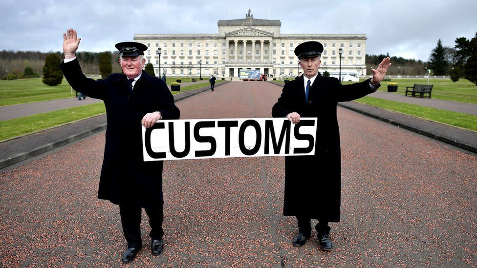 """Two men dressed as customs officers take part in a protest outside Stormont against Brexit and it""""s possible effect on the north and south Irish border on March 29, 2017 in Belfast, Northern Ireland"""