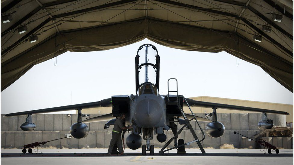 Refuelling a Royal Air Force Tornado GR4 before it leaves Kandahar Airfield for the final time