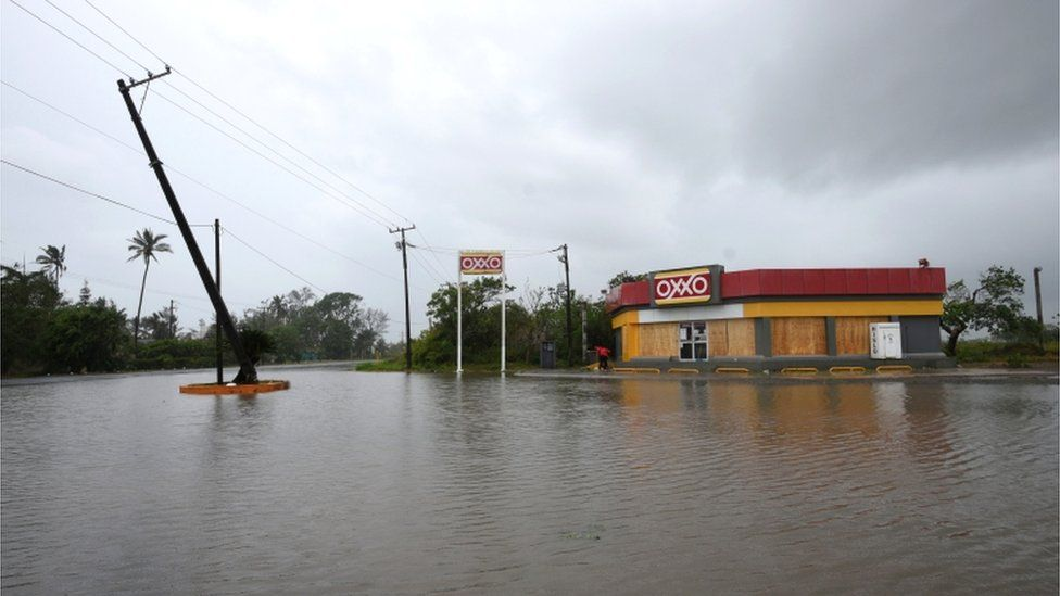 A road next to a convenience store is flooded after Hurricane Grace slammed into the coast with torrential rains, in Costa Esmeralda, near Tecolutla, Mexico, 21 August 2021