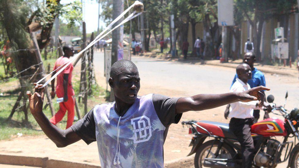 A man catapults a stone in Kisumu, Kenya - Monday 2 October 2017