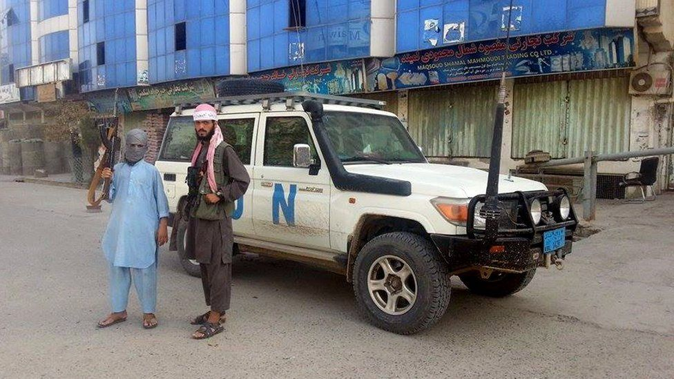 Taliban fighters in a seized Red Cross vehicle