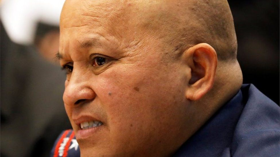 Philippine National Police chief General Ronald dela Rosa listens to a policeman's testimony during a Senate investigation of a kidnapped South Korean businessman that was allegedly killed by policemen at the police headquarters in Pasay, Metro Manila, Philippines January 26, 2017.