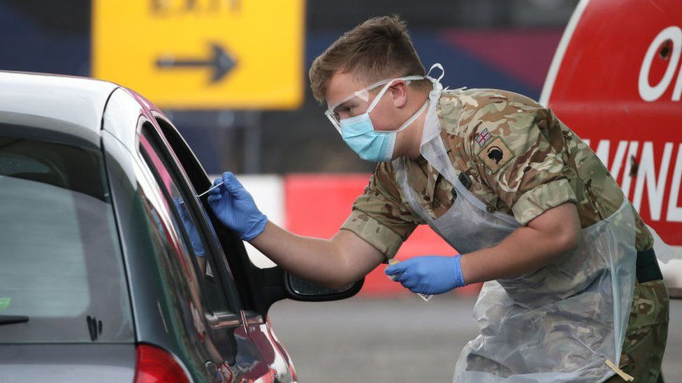 A soldier from 2 Scots Royal Regiment of Scotland takes a test sample at a Covid-19 testing centre at Glasgow Airport in April 2020