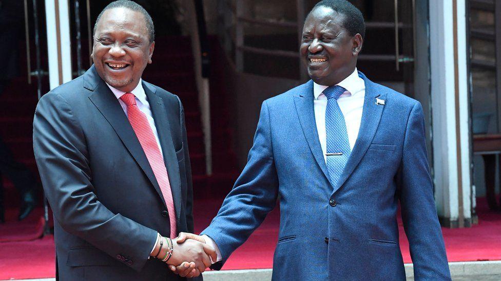 President Uhuru Kenyatta (L) and Raila Odinga (R) shaking hands in February 2018