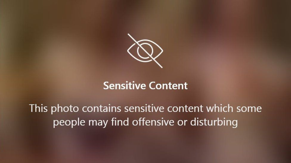 """A sensitive content warning. It reads, """"this photo contains sensitive content which some people may find offensive or disturbing""""."""