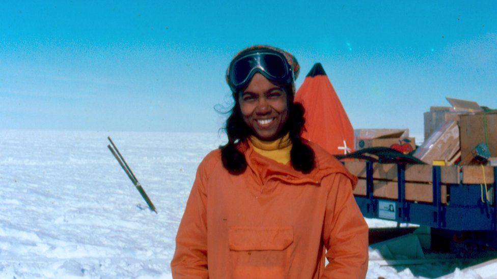 Sudipta stands in ice landscape