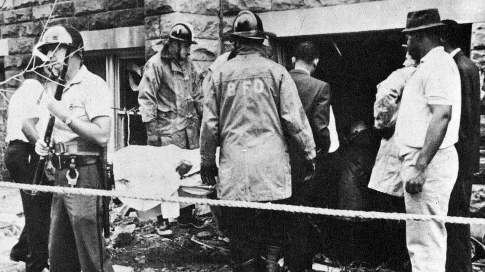 A victim is removed from the site of the Baptist Church Bombing