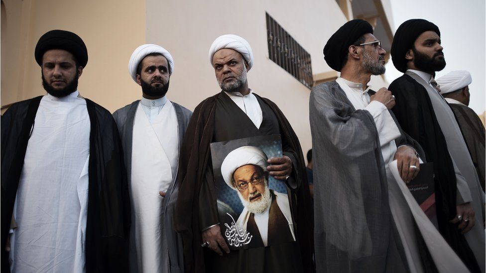 Bahraini Shiite clerics attend a protest against the revocation of the citizenship of top Bahraini Shiite cleric