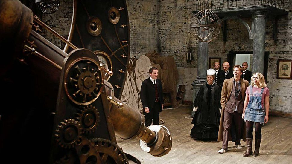 A scene from Doctor Who, There's an old castle featuring five people in the period costume as well as Dr Who (David Tennant) and his assistant (Billie Piper)