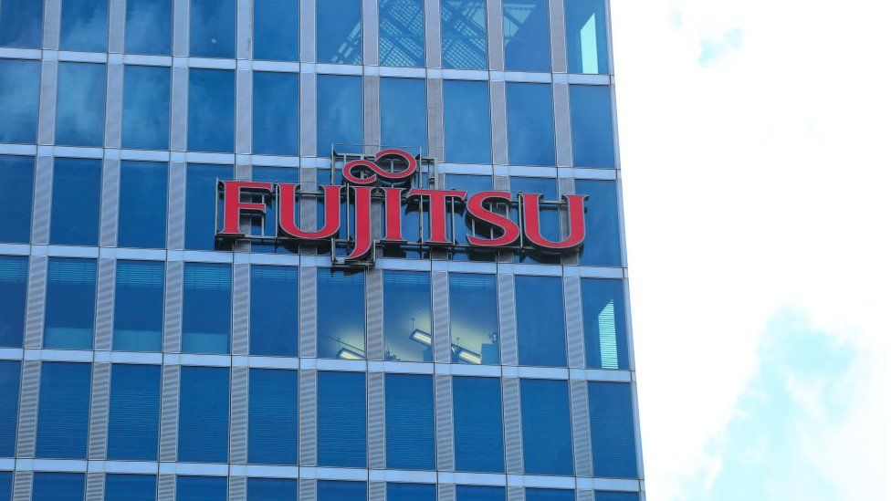 The logo of Japanese multinational information technology equipment and services company Fujitsu is seen on a skyscraper in Munich.