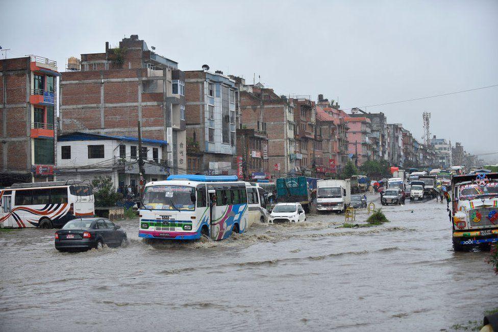 Vehicles travelling through water logged road at Banepa, Kavrepalanchok, Nepal on Friday, July 12, 2019.