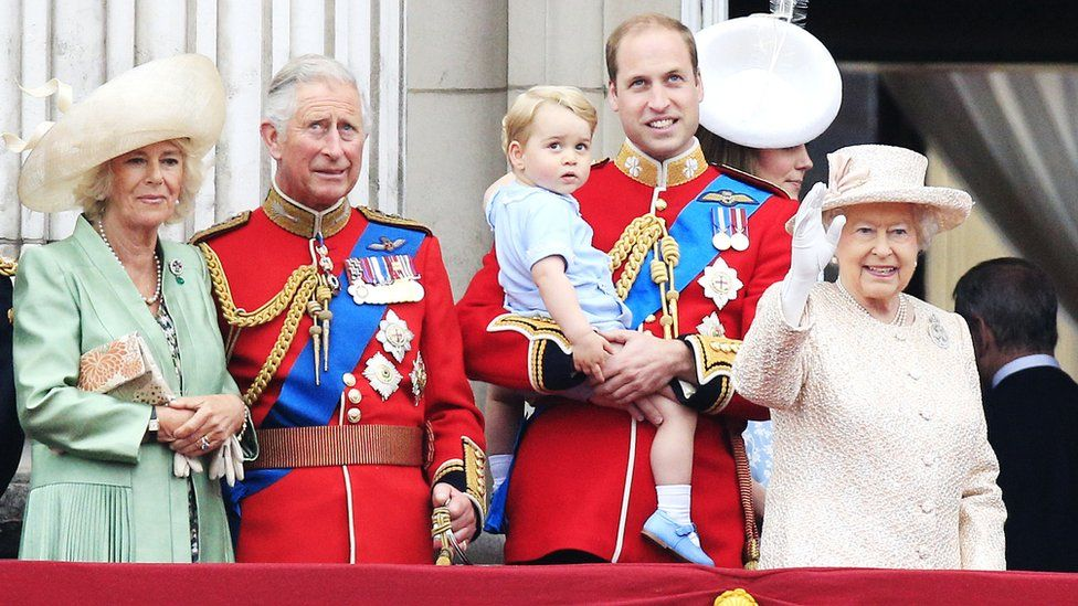 Prince Charles alongside his grandson Prince George