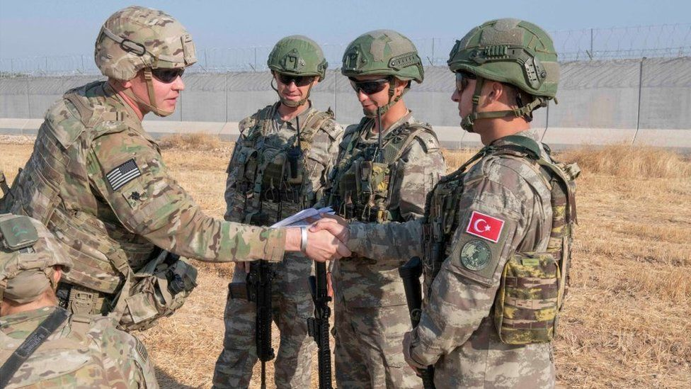 In this handout provided by the U.S. Army, U.S. and Turkish military forces conduct the third ground combined joint patrol inside the security mechanism area in northeast Syria, Oct. 4, 2019.