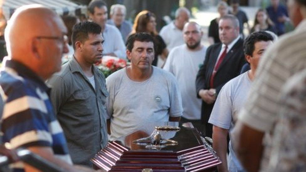 The coffin of Diego Angelini, one of the five Argentine citizens who were killed in the truck attack in New York on October 31, arrives at the Dissidents Cemetery in Rosario, Argentina November 6, 2017.
