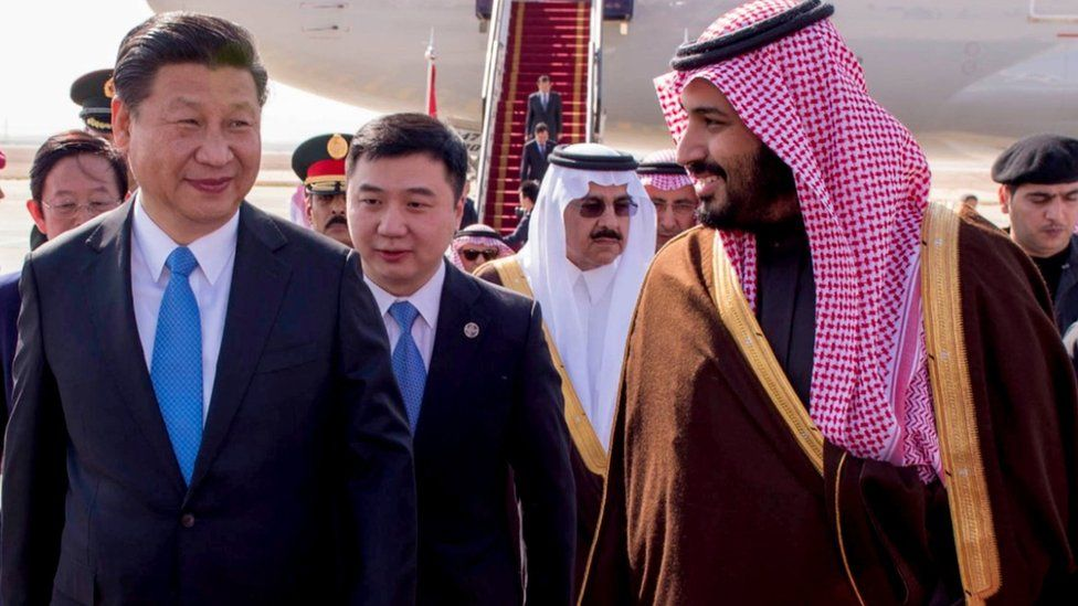Chinese President Xi Jinping is greeted at Riyadh's airport on Tuesday by Saudi Arabia's Deputy Crown Prince and Defence Minister, Mohammed bin Salman