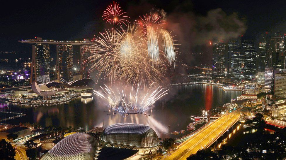 """Fireworks explode above Singapore""""s financial district at the stroke of midnight to mark the New Year""""s celebrations on Sunday, Jan. 1, 2017, in Singapore."""