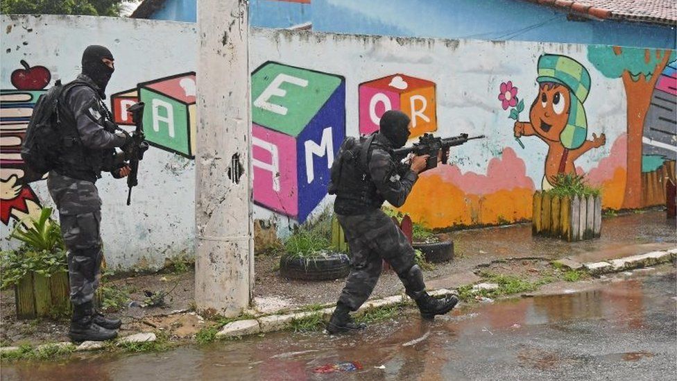 Special military police shock troops patrol near the Vila Kennedy favela in Rio de Janeiro, Brazil, on February 23, 2018.