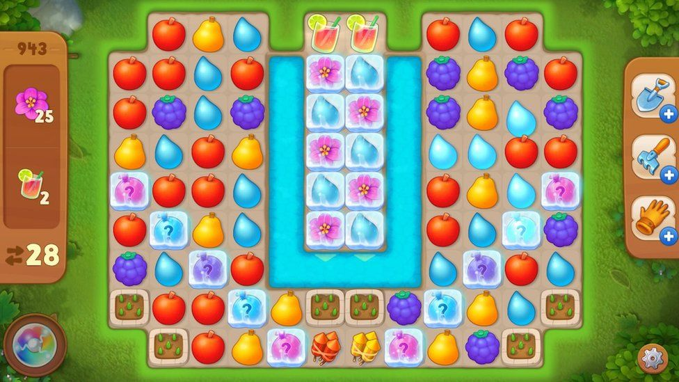 A series of coloured tiles shaped like fruit are arranged in a grid pattern in this mobile gameplay screenshot