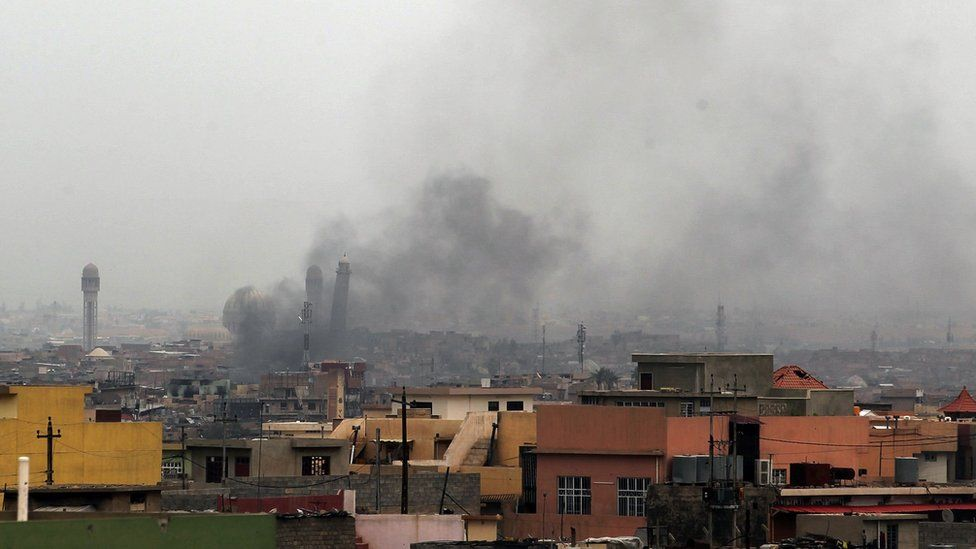 Smoke billowing in west Mosul, near the al-Nuri mosque and its leaning minaret