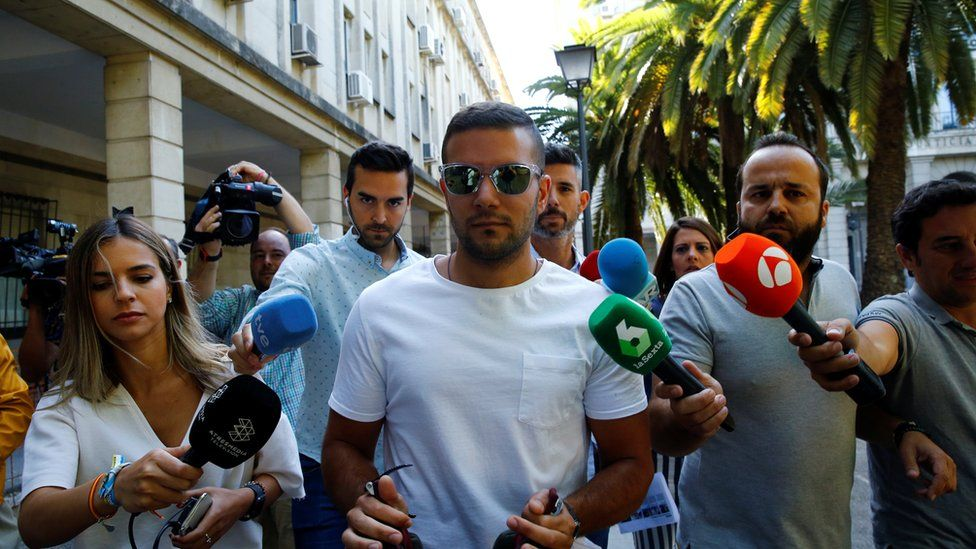 """Angel Boza, a member of the group known as La Manada (""""The Wolf Pack""""), exits a courthouse in Seville, Spain, June 21, 2019"""