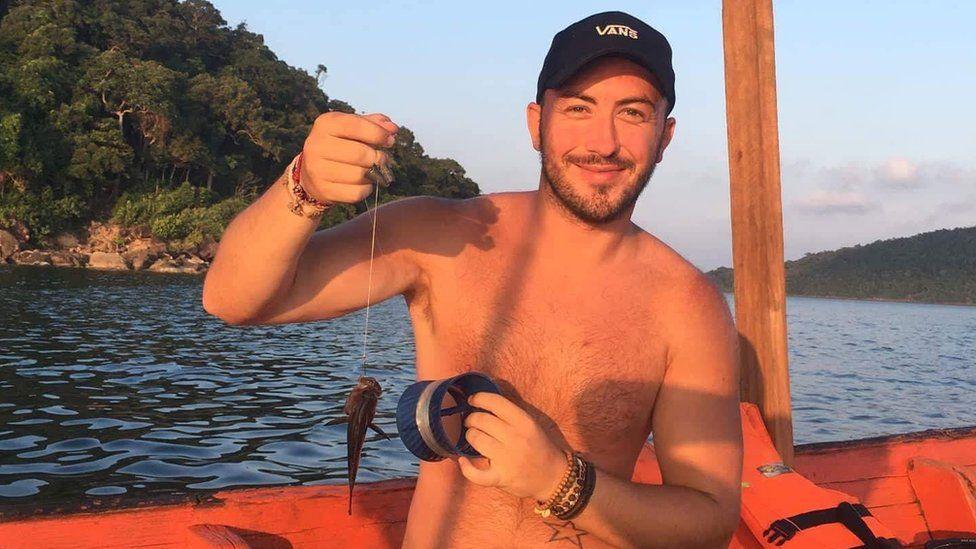 Calvin Hill pictured fishing in Cambodia