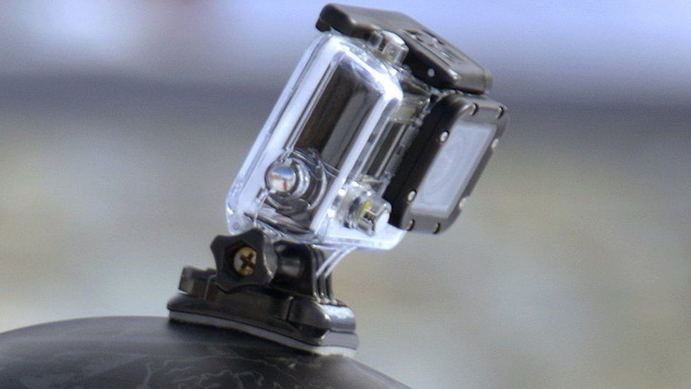 A GoPro camera attached to a helmet