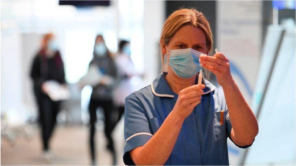 Nurse with vaccine
