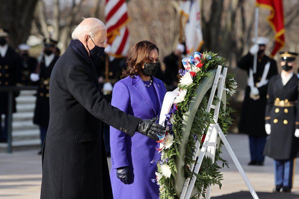 President Joe Biden and Vice President Kamala Harris lay a large wreath together