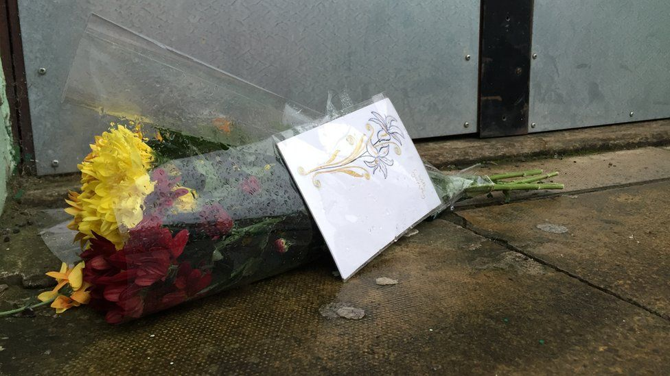 Flowers left on the steps of the mosque