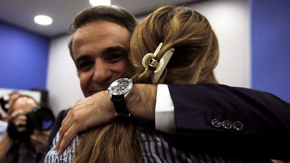 New Democracy leader Kyriakos Mitsotakis is congratulated at the party's headquarters in Athens, 6 July