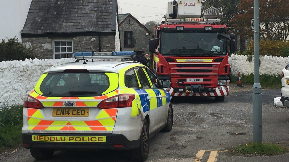 A police car and a fire engine at the scene