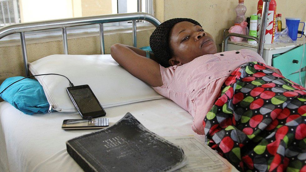A victim of the collapsed Reigners Bible Church International building receives treatment at the university teaching hospital in Uyo, Nigeria, 12 December