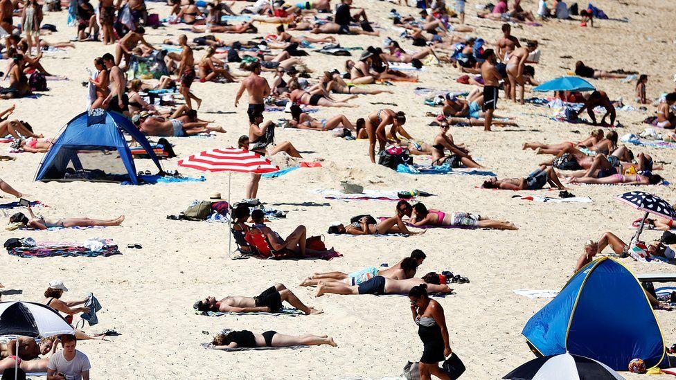 People enjoy the beach in Sydney