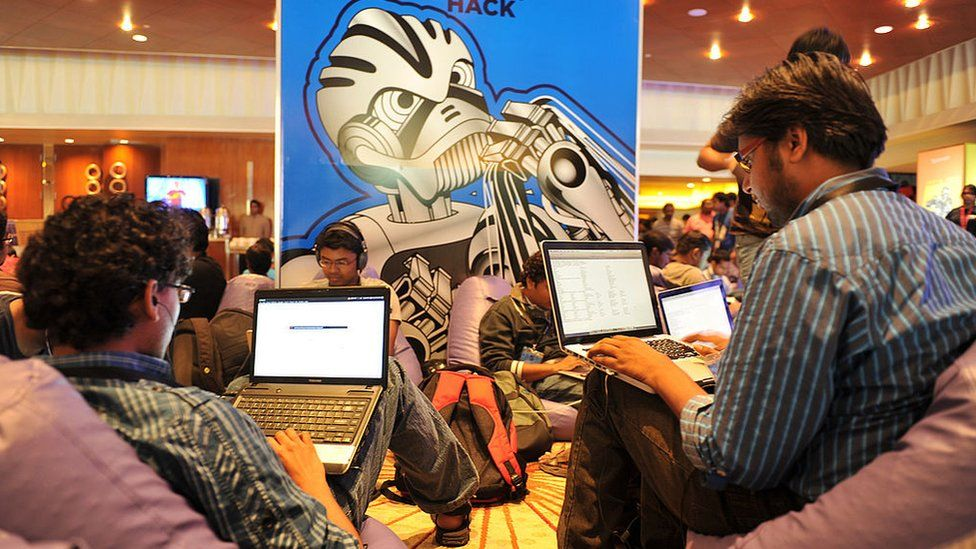 Participants use their laptop computers during the fifth edition of Open Hack India
