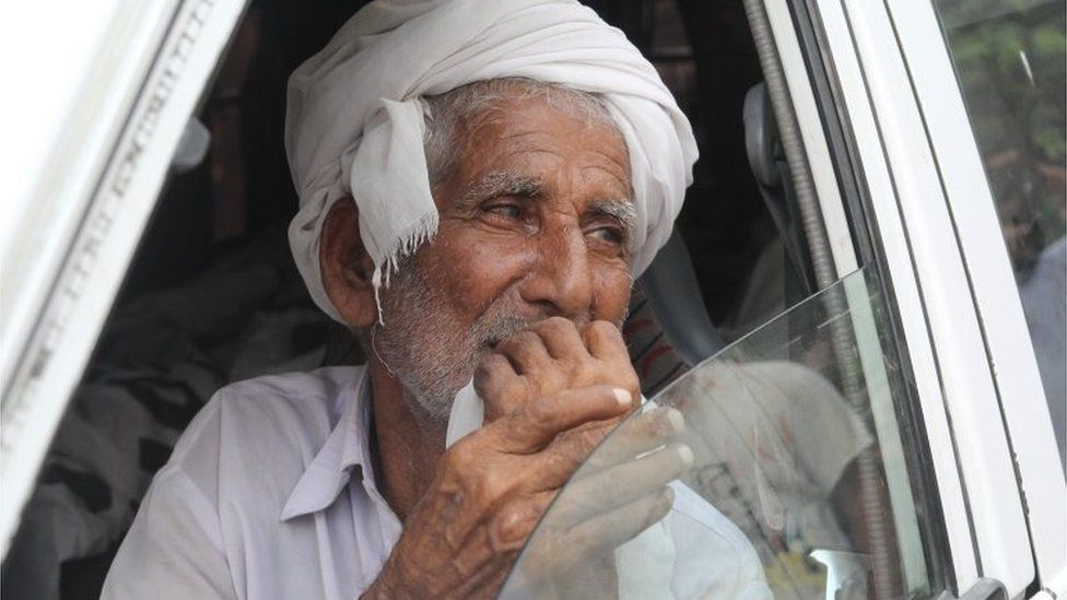 Father of social media celebrity, Qandeel Baloch mourns as he sits in an ambulance carrying the body of Qandeel in Shah Sadar Din village, around 130 kilometers from Multan on July 17, 2016.