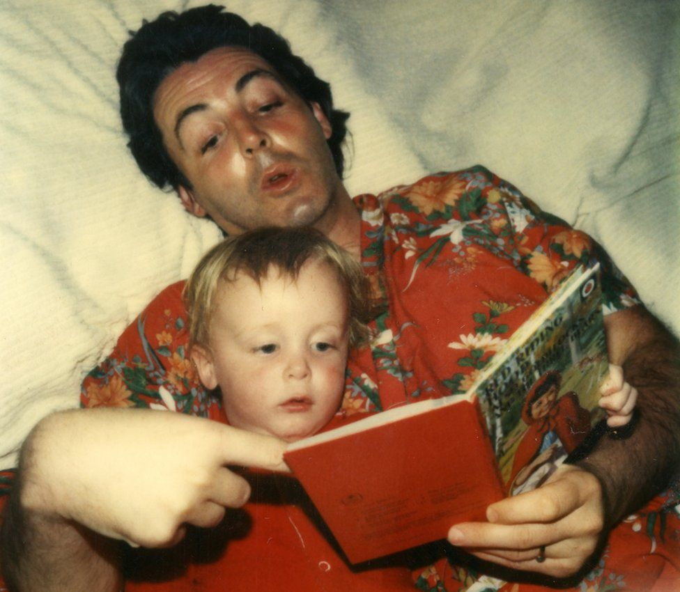 Paul McCartney reading to his son James