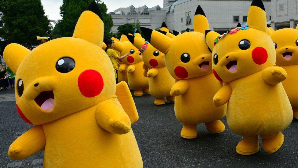 Dozens of Pikachu characters parade at the Landmark Plaza shopping mall in Yokohama