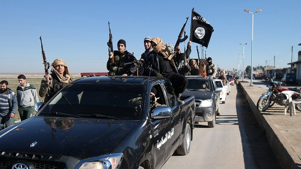 Islamic State militants on parade in Tal Abyad, Syria (24 December 2014)