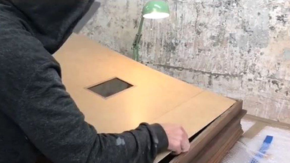 Banksy making a shredder to fit in a frame for Girl With Balloon