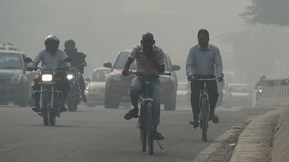 Cars on a smoggy road